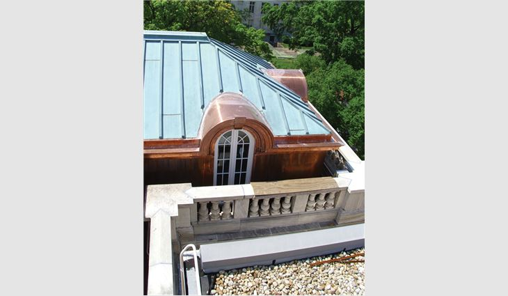 Work on the library included upper and lower built-in gutters, copper wall cladding, cornices between dormers, 26 radius eyebrow dormer cornices, barrel roof covers, and new historically accurate windows and framing.