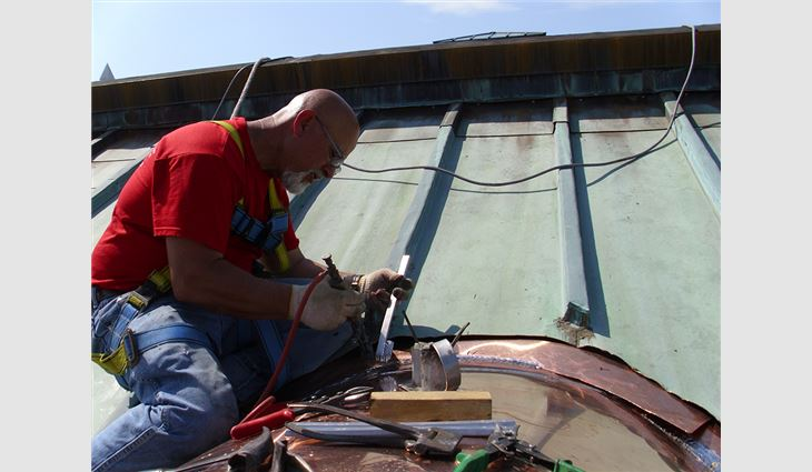 Custom-fabricated copper roof systems were installed on top of the barrel dormers.