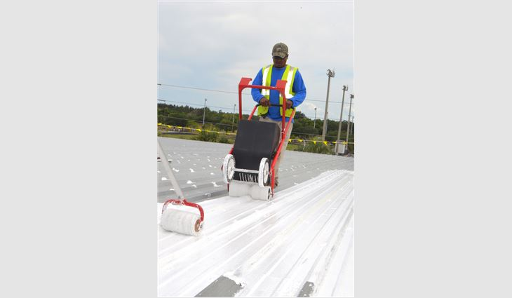 The silicone roof coating then was applied using a single-wide tank spreader.