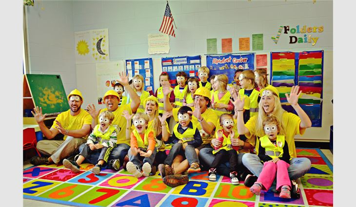The children received construction vests and posed for photos.