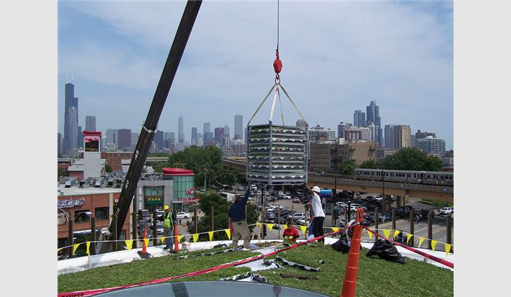 A crane was used to hoist roofing materials.