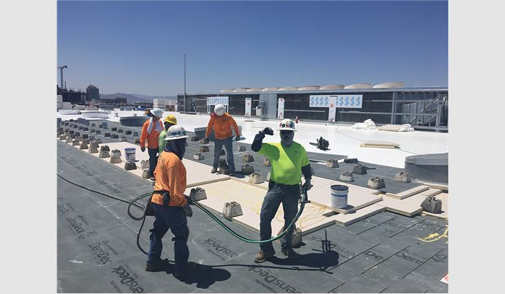 The Star Roofing crew worked swiftly to temporarily repair Burton Barr Central Library's roof system and then later installed a new PVC membrane roof system on the buildings.