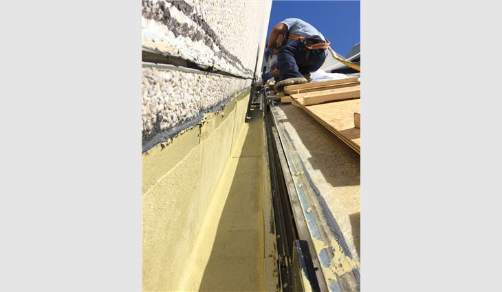 A new liquid-applied reinforced polymer membrane waterproofing system was developed to integrate with the skylights.