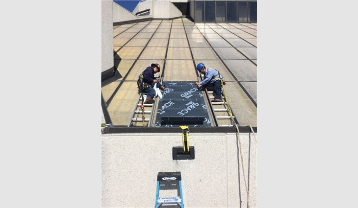 Workers accessed the 12th floor by removing a skylight panel and installing a temporary hatch.