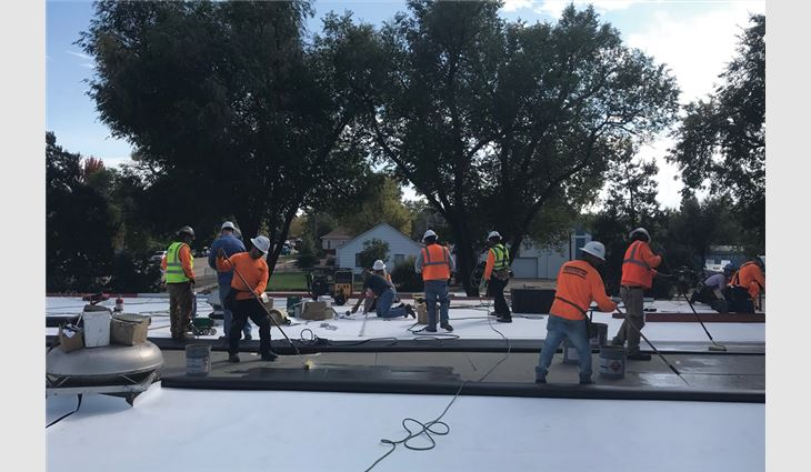 Employees at Front Range Roofing Systems LLC, Greeley, Colo., donated their labor to install a new TPO membrane roof system on a school.