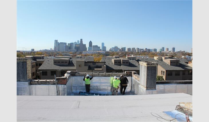 Texas Roof Management workers installed a new two-ply polymer-modified bitumen roof system, including metal flashings, repairs to the roof deck and parapet walls, and rebuilding an existing skylight, on Dallas Woman's Forum.