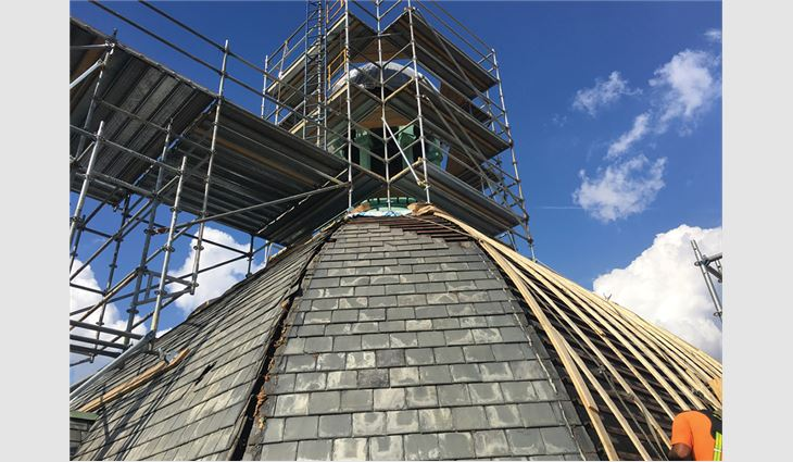 After removing the slate on the dome, American Roofing and Metal workers installed wood lathe strips vertically and three layers of 3/8-inch-thick plywood before applying underlayment and installing slate.