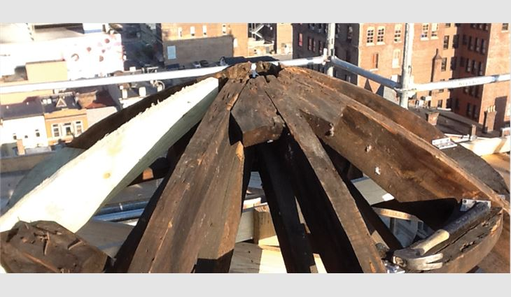 American Roofing and Metal workers replaced some structural members on the cupola and rebuilt the deck.