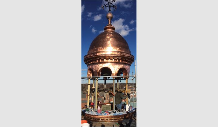 A full-scale replica of the cupola base was built in Steinrock Roofing and Sheet Metal's fabrication shop. Workers clad the cupola with soft copper in flat-locked panels. More than 10,700 pounds of copper were used on the project.