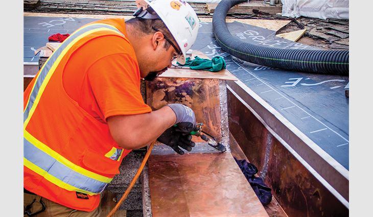 Craftsmen formed copper over plinthe blocks and soldered all joints