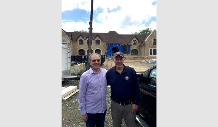 Stuart Matthews, founder of Northern Roof Tiles U.S. Inc., Wilmington, Del., and Kevin Lyons, steep-slope president of Hayden Building Maintenance Corp., West Nyack, N.Y.