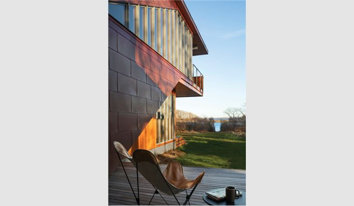 Workers used 20-ounce flat-seam copper wall panels to create exterior wall coverings.
