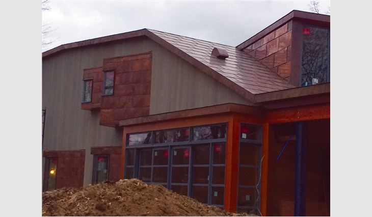 TRM Enterprises craftsmen also custom-created and installed copper built-in gutters, downspouts and roof edge fascia trim elements.