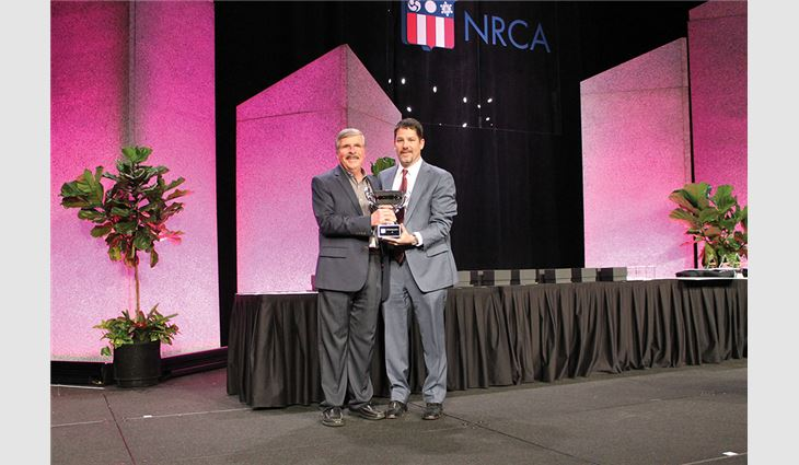NRCA Chairman of the Board-Elect Nick Sabino (right) presented the Charlie Raymond Award to Jim Slauson, vice president of GM specialty products for GAF, Parsippany, N.J.