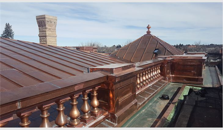 The main roof's perimeter includes an entablature detailed with a copper balustrade system composed of more than 140 spun-copper balusters in 12 sections.