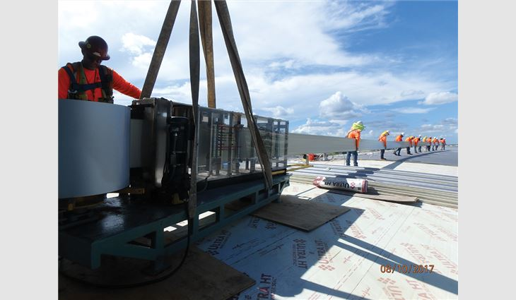 Roof panels with lengths up to 170 feet were rolled on the roof.