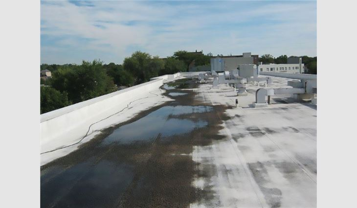 Photo 5: The crickets on this roof are too small for the conditions, leading to ponding water.