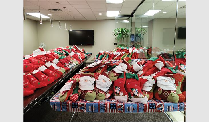 Twice per year, employees at Conley Group Inc. stuff hundreds of Christmas stockings for members of the armed forces.