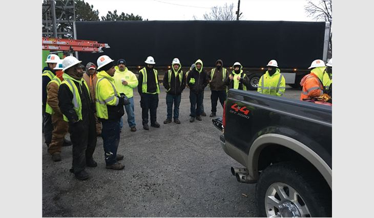 "Every morning, the Nations Roof of Ohio crew met for a ""safety huddle."""