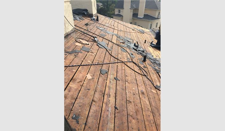 Workers removed three layers of asphalt shingles.