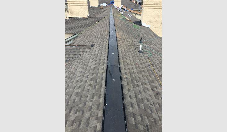 Next, asphalt shingles were installed.