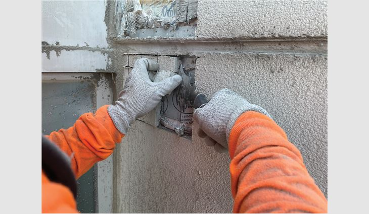 Test cuts were performed to inspect the condition of existing building components.