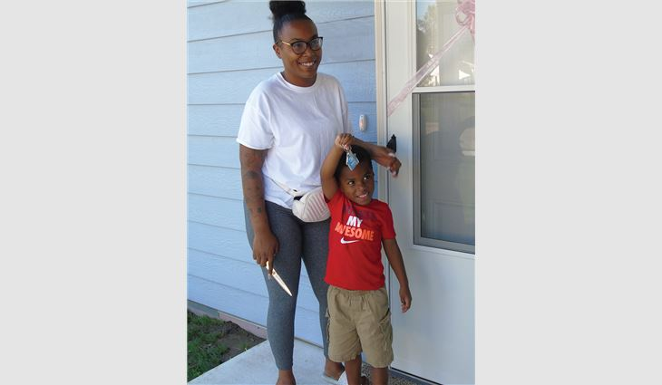 Denise Woolheater, a single mom with six children, was the 2020 recipient of Rhoden Roofing's annual free roof system giveaway. Workers removed four layers of roofing material down to the deck, replaced the roof deck and gutters, and installed new asphalt shingles on Woolheater's home.