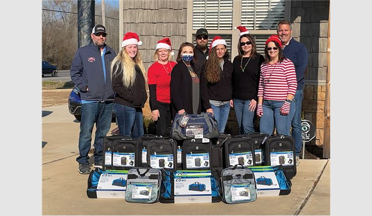 During a six-week period, whenever Arkansas Roofing Kompany sold a new roof system, employees purchased a new suitcase along with toiletry items for a child in Faulkner County's foster care system.