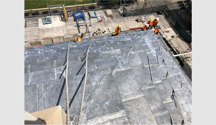 On the ziggurat roof, workers removed the existing lead sheet roof system down to limestone risers, replaced risers as needed and then applied primer and underlayment.