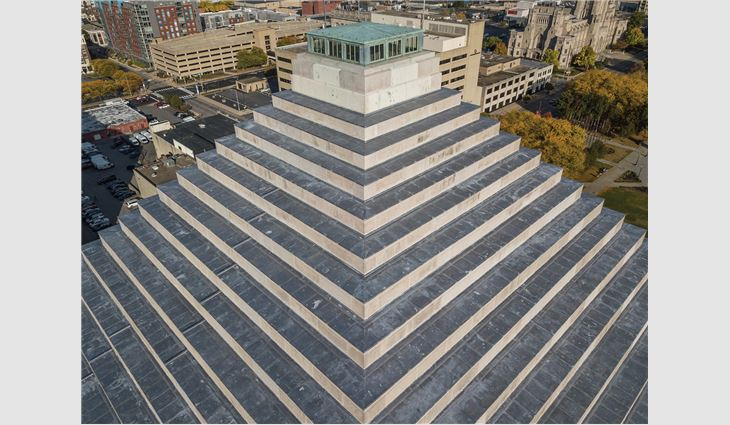 Above photo: an aerial view of the Indiana War Memorial's newly completed ziggurat roof system Photos on left: the roof systems under construction